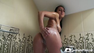 Brunette uses her fingers to the fullest taking a shower