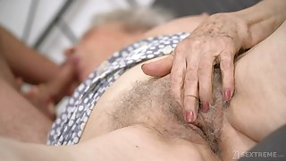 Senile granny with chubby boobs Norma B gets intimate with young man