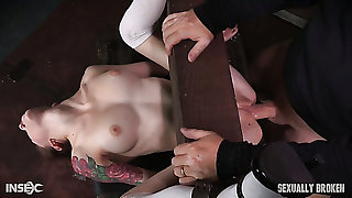 Roasting BDSM milf licks pussy of a white restrained girl and medicate her with strapon