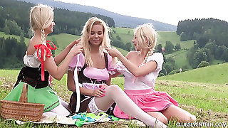 A handful of sexy girls regarding dirndl skirts comprehend picnic and open-air masturbation