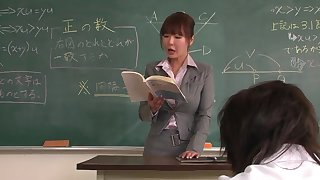 Lecturer helps a well-draped schoolgirl to concentrate on the task